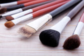 Professional makeup brush on white wooden background — Stock Photo