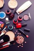 Various makeup products on dark black background with copyspace — Foto Stock