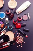 Various makeup products on dark black background with copyspace — Foto de Stock