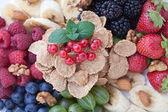 Breakfast - berries, fruit and muesli — Stock Photo