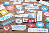 KIEV, UKRAINE - AUGUST 22, 2015:Collection of popular social media logos printed on paper:Facebook, Twitter, Google Plus, Instagram, Pinterest, Skype, YouTube, Linkedin and others — Stock Photo