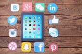 Social media icons with digital tablet — Stock Photo