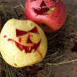 Chinese pear and apple for halloween on hay — Stock Photo #56253409