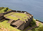 Old fortess over the water in St Kitts — Stock Photo