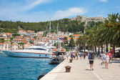 Hvar town's harbor with walking tourists — Stock Photo