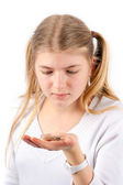 Girl holding hearing aid — Stock Photo