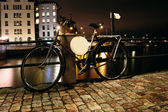 Bicycle at night near the pier on the background — Stock Photo