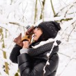 Girl photographs in winter forest — Stock Photo #65051019