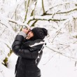 Girl photographs in winter forest — Stock Photo #65051023
