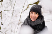 Portrait of a beautiful girl in winter forest — Stock Photo
