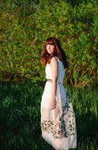 Beautiful girl in a white dress — Stock Photo