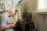 Busy Old Man Innovating Electronic Gadget — Stock Photo