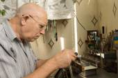 Serious Old Man Working For Electronic Device — Stock Photo