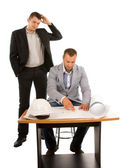 Two architects or builders working on a plan — Стоковое фото