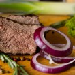 Sliced Beef and Red Onions on Chopping Board — Stock Photo #55008227
