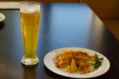 Fried Main Dish on White Plate and Glass of Beer — Stock Photo