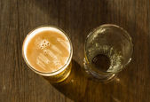 Overhead of Glass of Beer Beside Empty Glass — Stock Photo