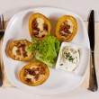 Постер, плакат: Potato Skins Appetizer on Plate