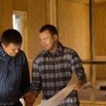 Architects Discussing Building Interior Design — Stock Photo #56492567