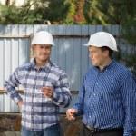 Two site engineers enjoying a smoke break — Stock Photo #56492773