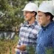 Two engineers with serious expressions — Stock Photo #56492783