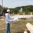 Foreman checking building supplies on site — Stock Photo #56492883