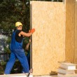 Construction workers installing prefab walls — Stock Photo #56493017