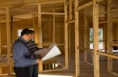 Building Architects Looking at Blueprint — Stock Photo