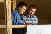 Building Architects Looking at Blueprint Seriously — Stock Photo