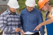 Builder, engineer and architect having a meeting — Stock Photo