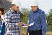 Two architects checking specifications — Stock Photo