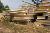 Stacked of Building Materials on Grassy Landscape — Stock Photo