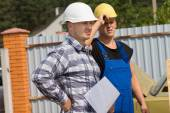 Engineer and building contractor on site — Stock Photo
