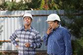 Two engineers taking a smoke break — Stock fotografie