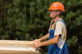 Happy young workman on a building site — Stock Photo