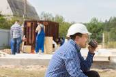 Workman drinking coffee on a building site — Foto de Stock