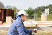 Thirsty builder taking a coffee break — Stock Photo