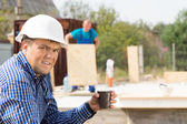 Male Engineer Holding Cup of Coffee at Site — Stock Photo