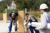 Architect or engineer on a building site — Stock Photo
