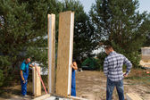 Builders aligning insulated wall panels — Stock Photo