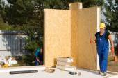 Workmen busy erecting insulated walls — Stock Photo