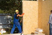 Construction workers installing prefab walls — Stock Photo