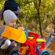 Little girl playing with a front end loader — Stock Photo #57398287