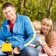 Happy young family posing together outdoors — Stock Photo #57398299