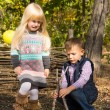 Young boy and girl playing outdoors in woodland — Stock Photo #57398391