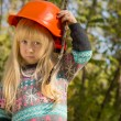 Cute little girl adjusting her hardhat — Stock Photo #57398481