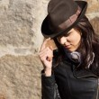 Fashionable woman wearing hat and leather jacket — Stock Photo #57398833