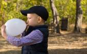 Cute Kid Inflating White Balloon Seriously — Stock Photo