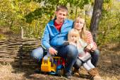 Happy young family outdoors in woodland — Stok fotoğraf