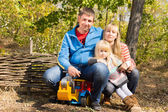 Happy young family outdoors in woodland — ストック写真